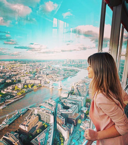 Woman lookout out from London's Shard building